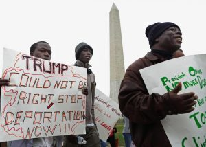Immigrant families and their supporters march past the Washington Monument on Dec. 15 to protest plans to target undocumented immigrants.